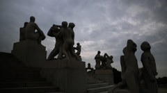 Silhouette overview of sculpture carved granite stone  monolith Vigeland Park - stock footage