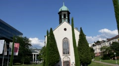 Church and bell ringing on blue sky background. With sound Stock Footage
