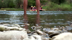 Legs of Man in a cool mountain river Stock Footage
