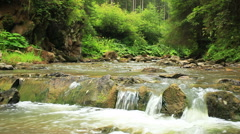 Small falls in the mountain river  close up. Sound Stock Footage