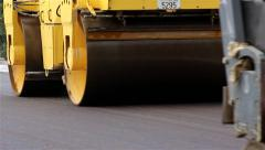 Road roller. Steamroller smoothing asphalt. Asphalting. Paving. Close up. Stock Footage