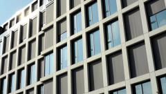 Modern building - offices - window with curtain - sun Stock Footage
