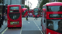 Lot of Red Busses at London Oxford Street Stock Footage