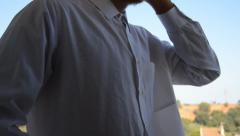 Man in Formal White Shirt Makes Call with his Smartphone Stock Footage