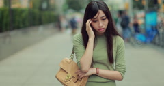 Young Asian woman walking worried depressed sad in city 4k - stock footage