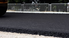 Road roller flattens asphalt. Steamroller. Tracking shot on right. Close up. - stock footage