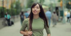 Young Asian Woman walking happy smiling on a city street 4k - stock footage