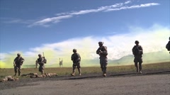 Special forces soldiers walk towards camera slow motion Stock Footage