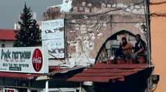 Western Asia Mediterranean Sea Israel Haifa 042 local residents sit on a roof Stock Footage