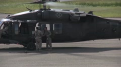 Blackhawk Helicopters taking off and landing from medical evacuation missions Stock Footage