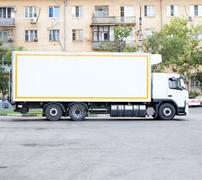 Big white modern commercial truck standing on parking lot. Indastrial trailer. Stock Photos