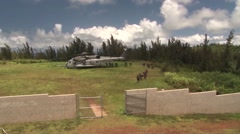 CH-53 Super Stallion helicopters drop off soldiers Stock Footage