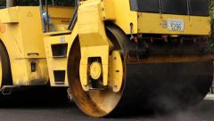 Steamroller smoothing asphalt. Road roller. Tracking shot on left. Close up. - stock footage