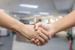 Hand holding hand isolated over white background - friendship, business, hand Stock Photos