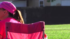 Soccer, football, woman in pink Stock Footage