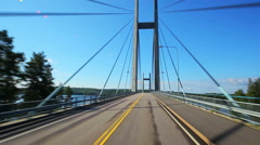 Road travel on bridge in Finland. Stock Footage