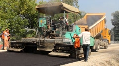 Asphalting. Machine for paving apply asphalt to road. Roadworks. - stock footage