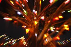 long exposure and zoom effect to christmas tree - stock photo