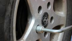 Untwisting The Bolts On The Wheel Stock Footage