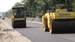 023 Road work. Paving. Asphalting. Road rollers flattens asphalt. Steamrollers. Stock Footage