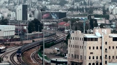 Western Asia Mediterranean Sea Israel Haifa 057 train in industrial area Stock Footage