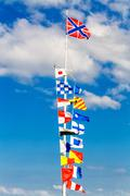 flags on flagpole - stock photo