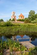 Russian summer landscape with ancient church on the background Stock Photos