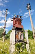 Power transformer against the blue sky background Stock Photos