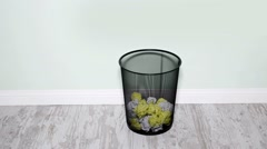 Paper wads in trashcan - stock footage
