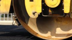 039 Road roller flattens asphalt. Steamroller. Tracking shot on right. Close up. - stock footage
