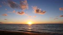Sunrise over calm ocean, Kapaa Beach, Kauai, Hawaii Stock Footage