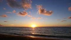 Sunrise over calm ocean, Kapaa Beach, Kauai, Hawaii Stock Footage