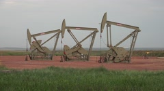 P03894 Oil Pumps in Bakken Oil Field in North Dakota Stock Footage