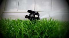 Oscillating lawn sprinkler watering grass in backyard Stock Footage