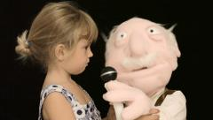 Little girl puppet sing 1 Stock Footage