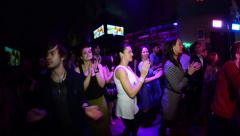 Crowd dancing and clapping in the club - stock footage