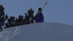 RIDER HOLDING HIS SKIS - stock footage