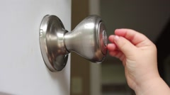 Toddler playing with doorknob - stock footage