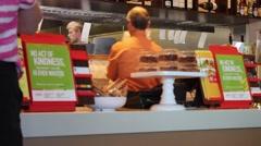 Staff at fast-food restaurant prepare orders Stock Footage
