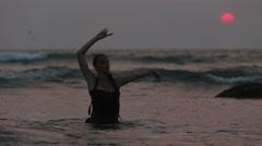 Girl Performers dance acrobatic stunts in the water Stock Footage