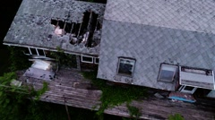 In air flight above wooden neglected abandoned farm house Stock Footage
