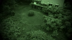 Night vision in air flight above wooden neglected abandoned farm house - stock footage