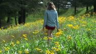 Stock Video Footage of Woman Walks In Yellow Flower Field