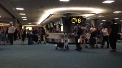 Interior yvr airport baggage claim with luggage spinning around conveyor. Stock Footage
