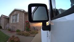 Side view of Jeep pulling into driveway and garage Stock Footage