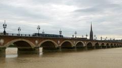 Tram passing over the Pont de Pierre bridge - Bordeaux France Stock Footage