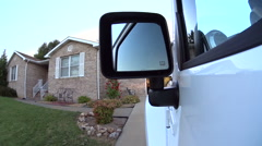 Backing Jeep out of driveway onto street Stock Footage
