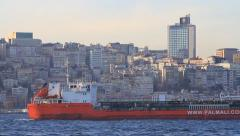 Large petroleum product tanker sails past the city Stock Footage