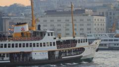 City passenger ship sails past Istanbul Chamber of Commerce Building Stock Footage