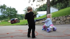 Boy blasts grandma and sister with leaf blower - stock footage